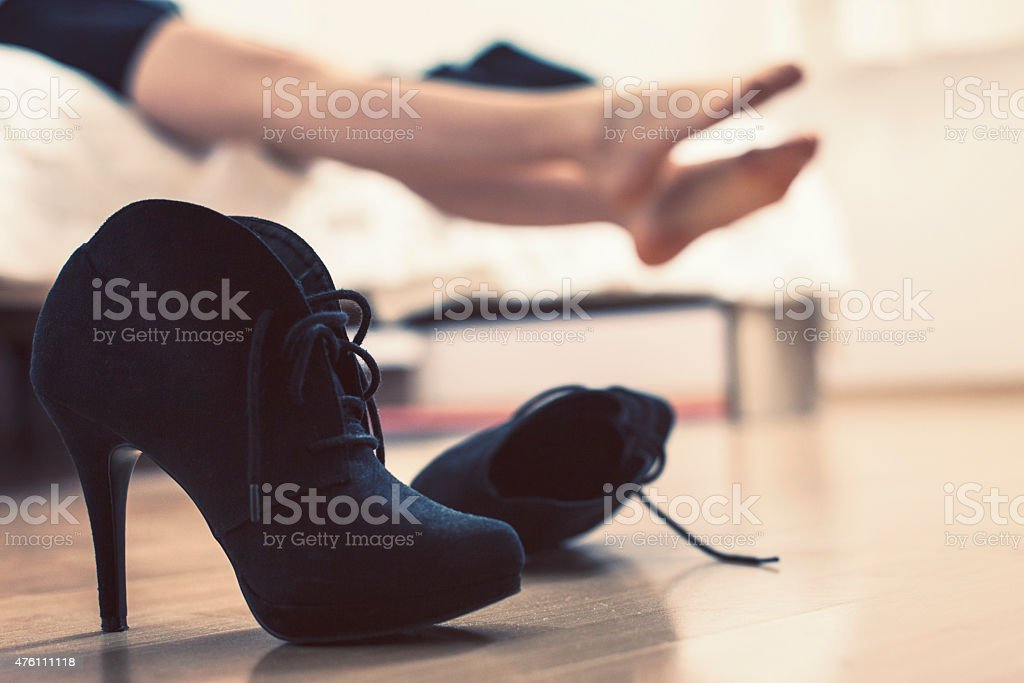 Woman stretching achy feet stock photo