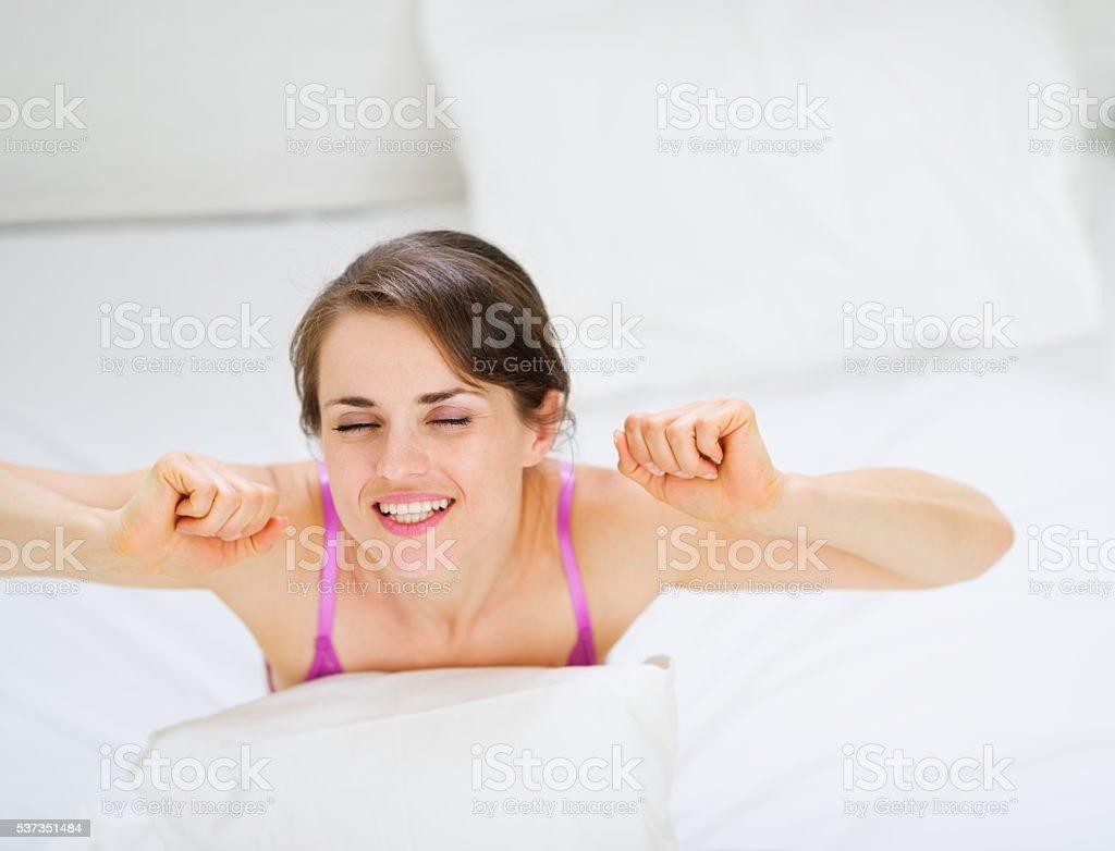 woman stretching after awake stock photo