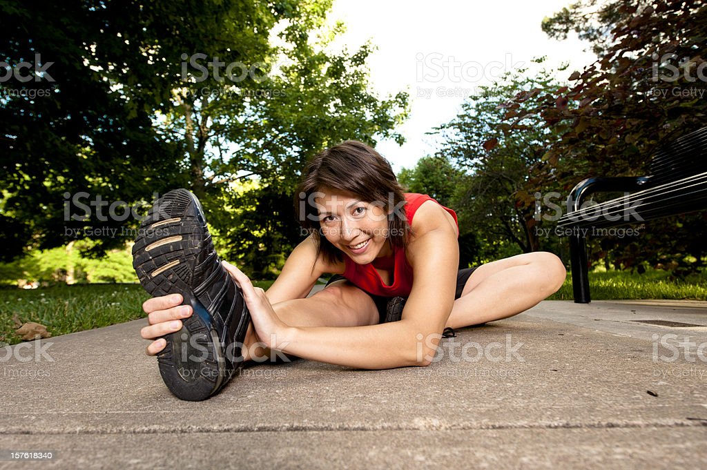 Woman stretching before a run. stock photo