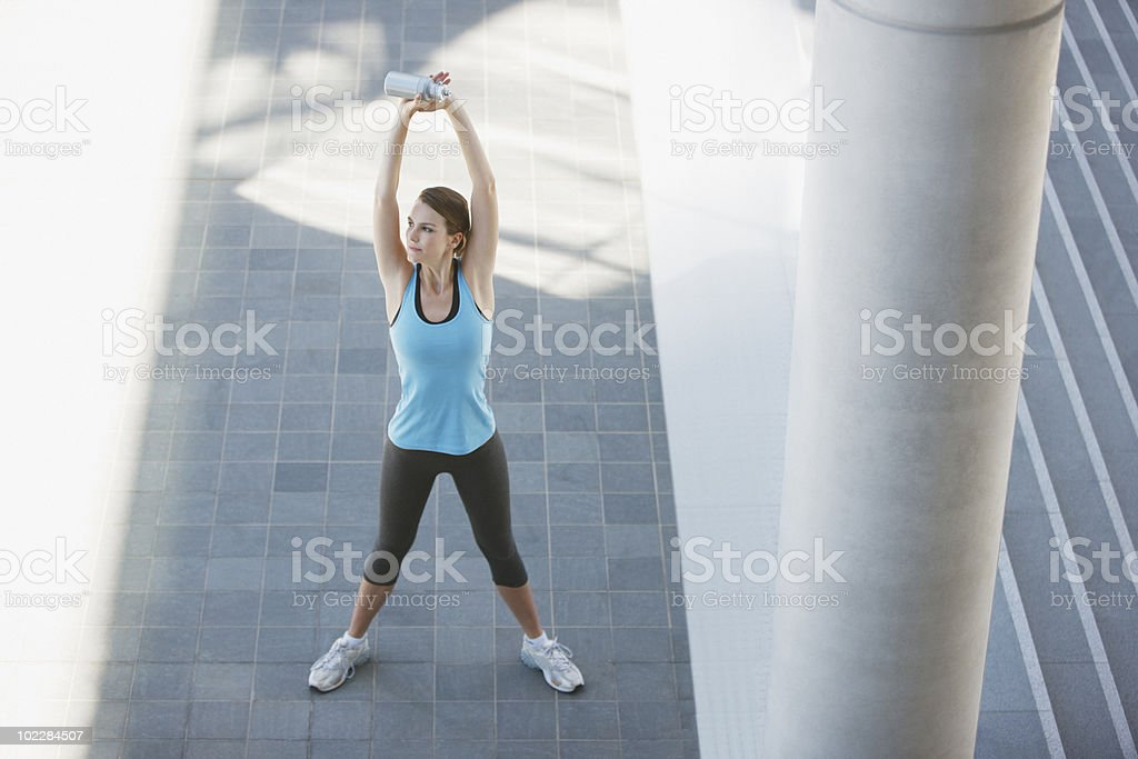Woman stretching before exercise royalty-free stock photo