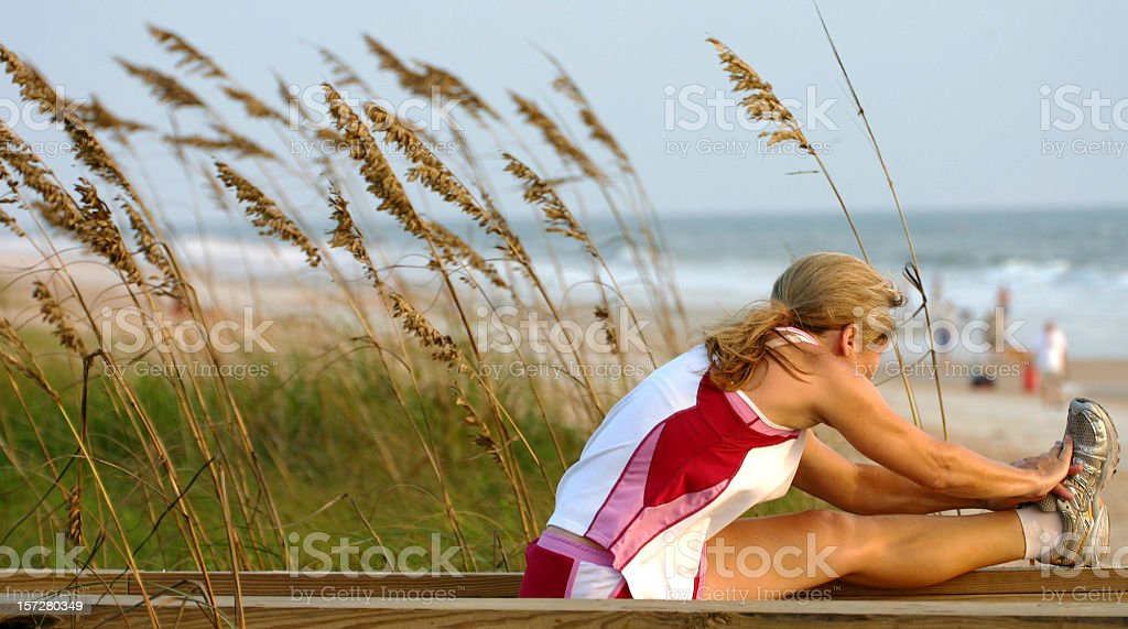 Woman Stretching Before Jog royalty-free stock photo