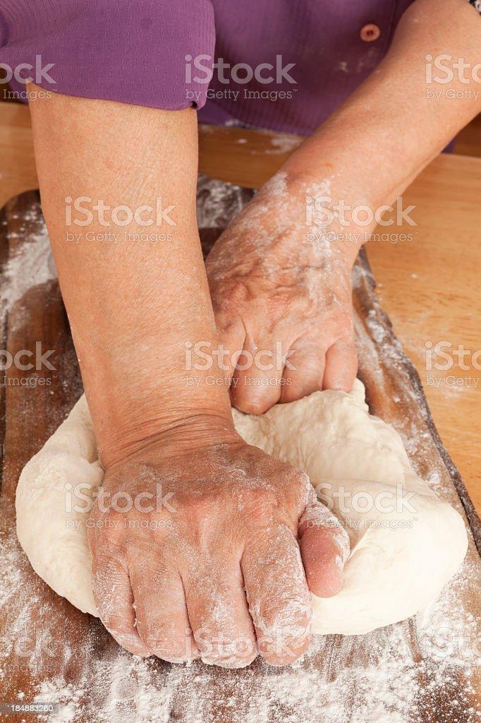 Woman stretching dough royalty-free stock photo