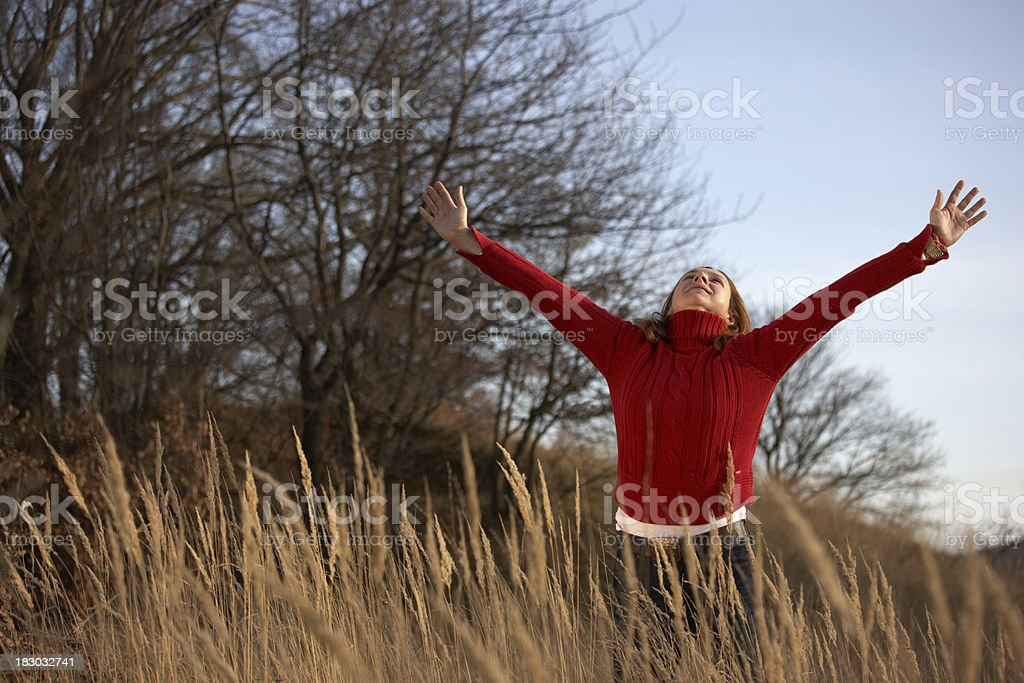 woman stretching her back in autumn stock photo