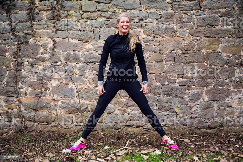 Woman stretching her body stock photo
