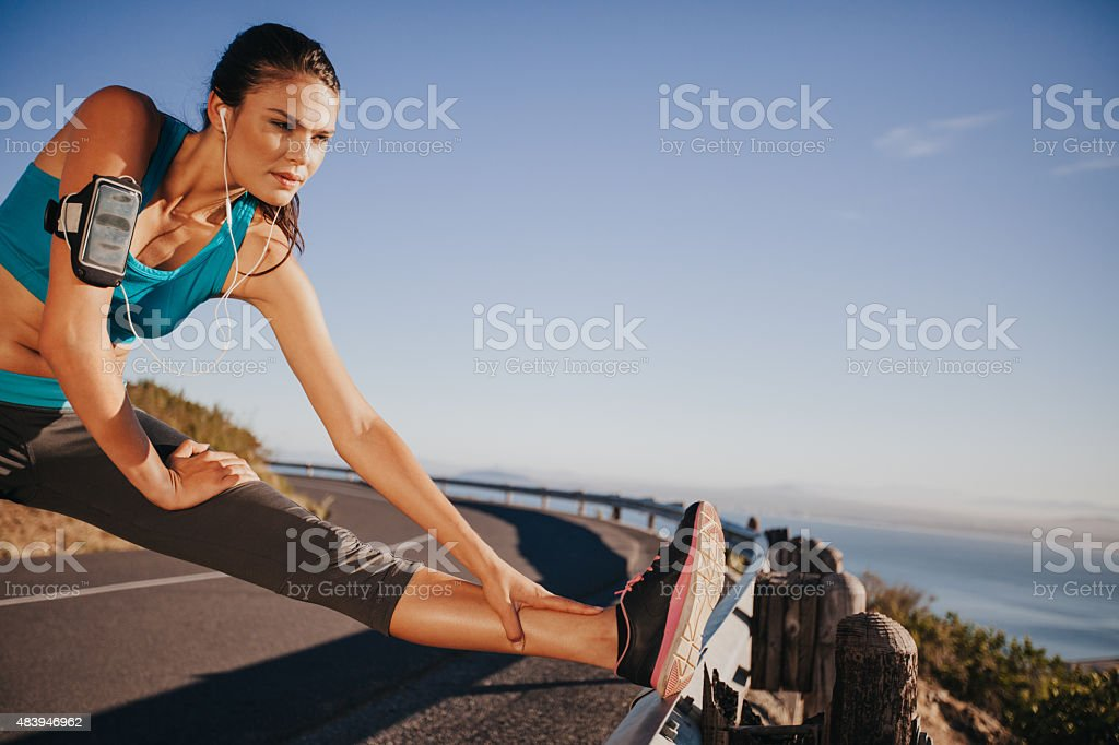 Woman stretching her legs before a run stock photo