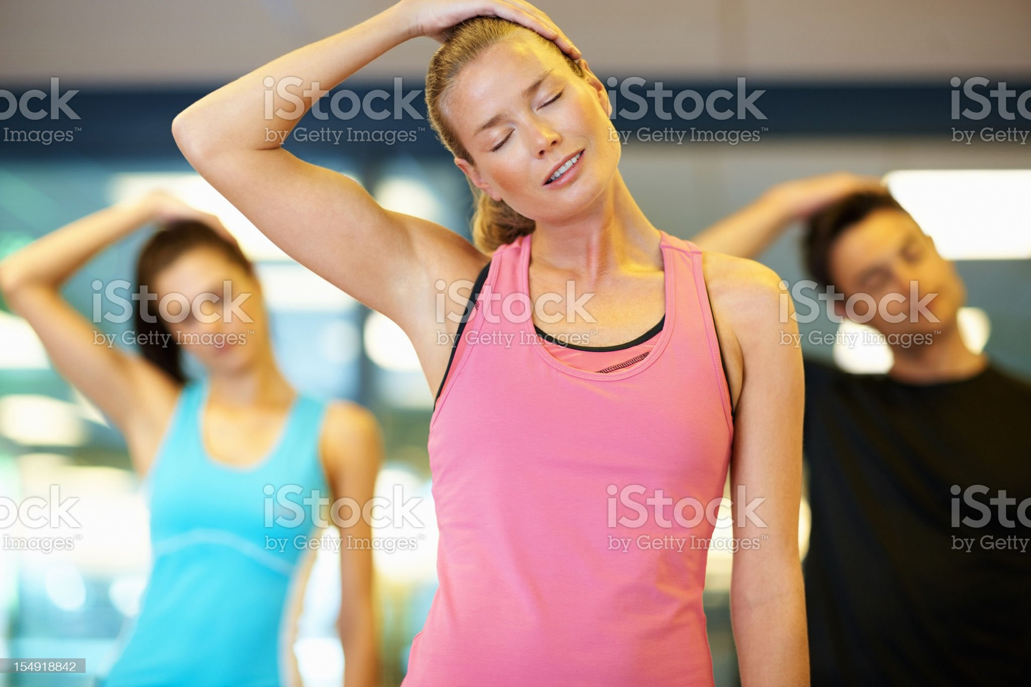 Woman stretching her neck  at gym royalty-free stock photo