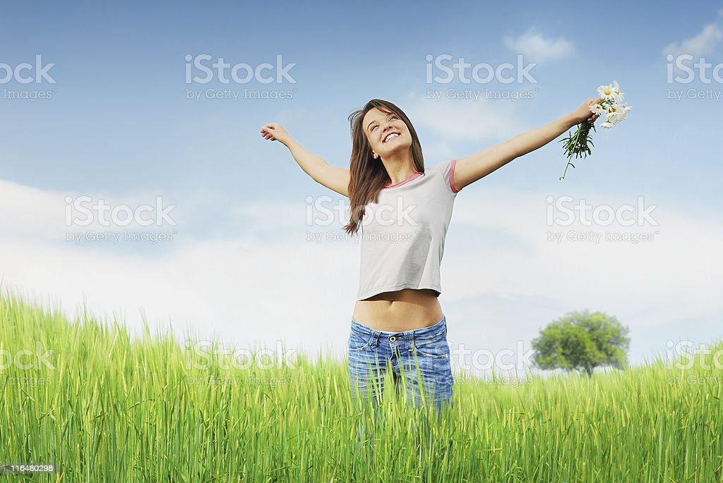 A woman stretching in a field in Detroit stock photo