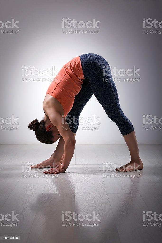Woman stretching in Ashtanga Vinyasa yoga asana stock photo