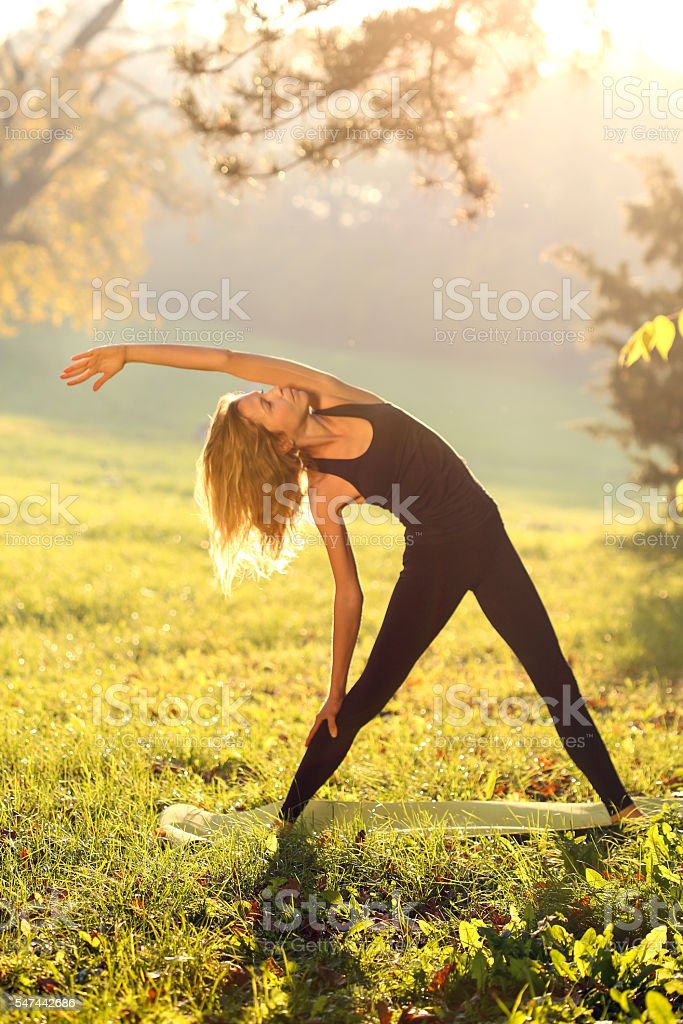 Woman stretching in nature stock photo