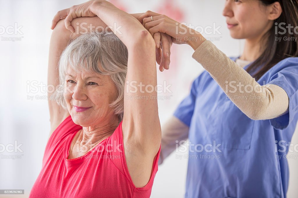 Woman Stretching in Physical Therapy stock photo