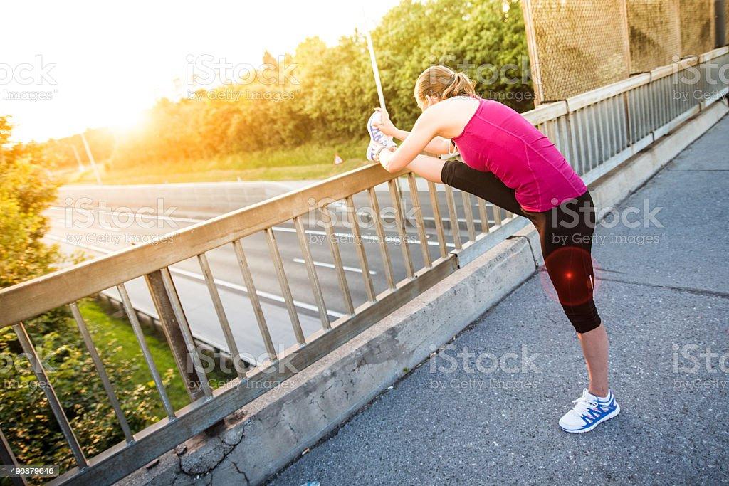 Woman stretching leg stock photo