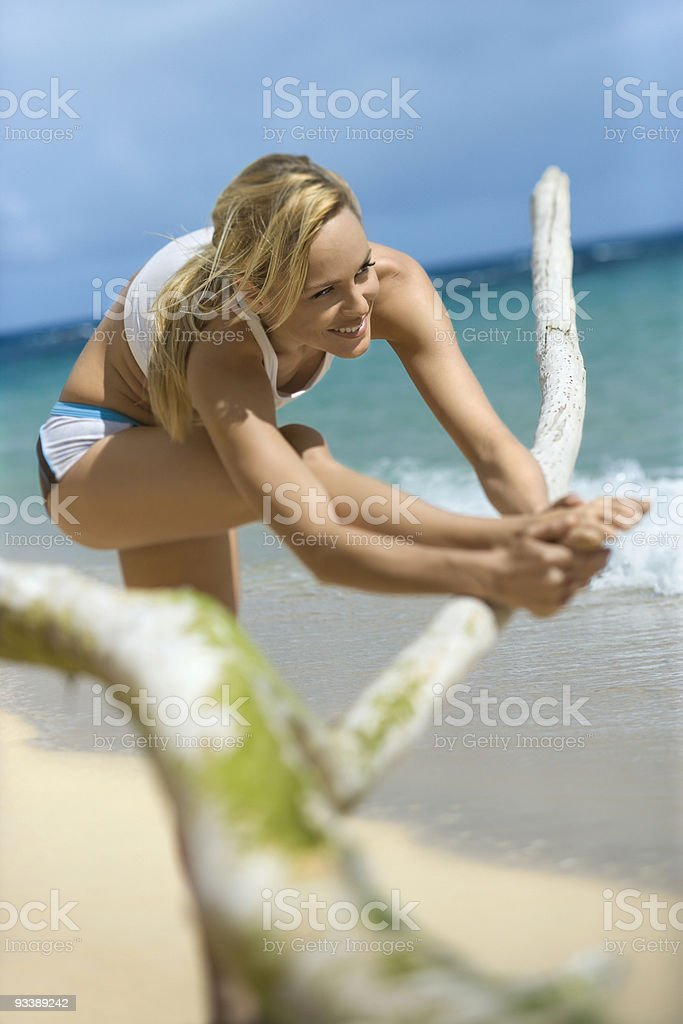 Woman stretching on beach. royalty-free stock photo