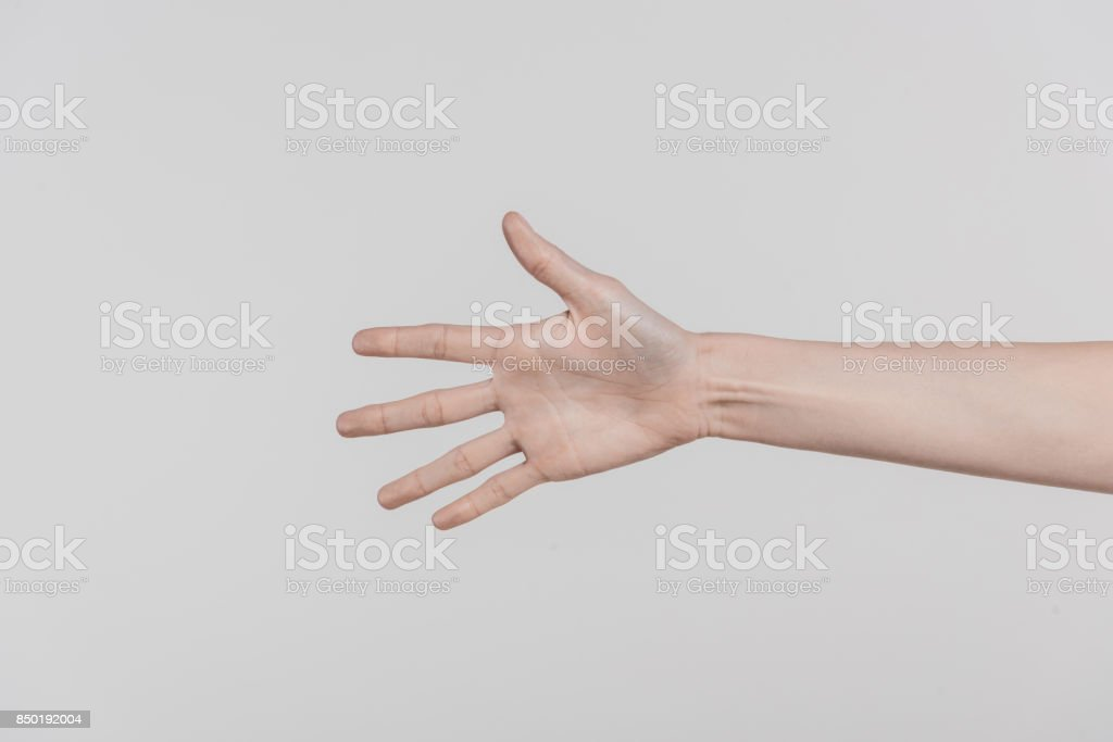 woman stretching out hand stock photo