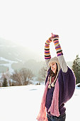 Woman stretching outdoors in snow