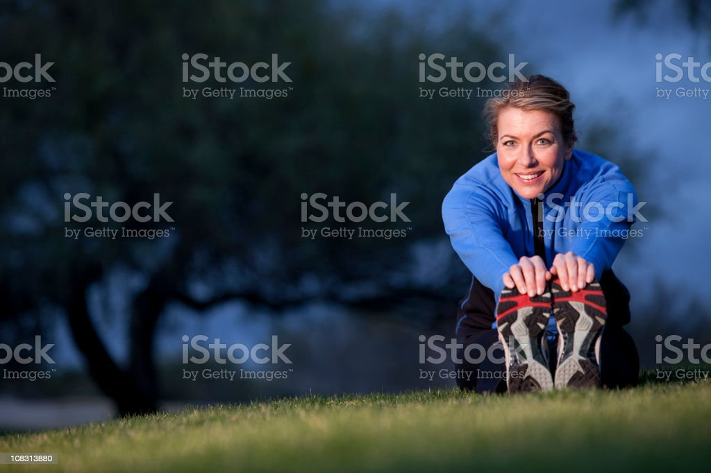 Woman stretching royalty-free stock photo
