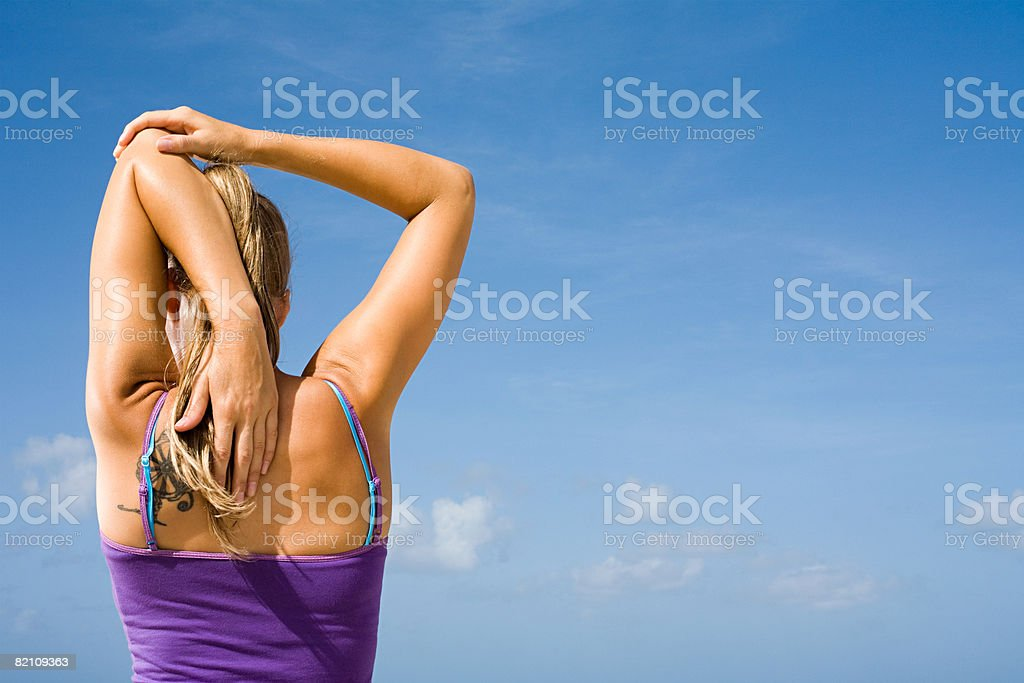 A woman stretching stock photo