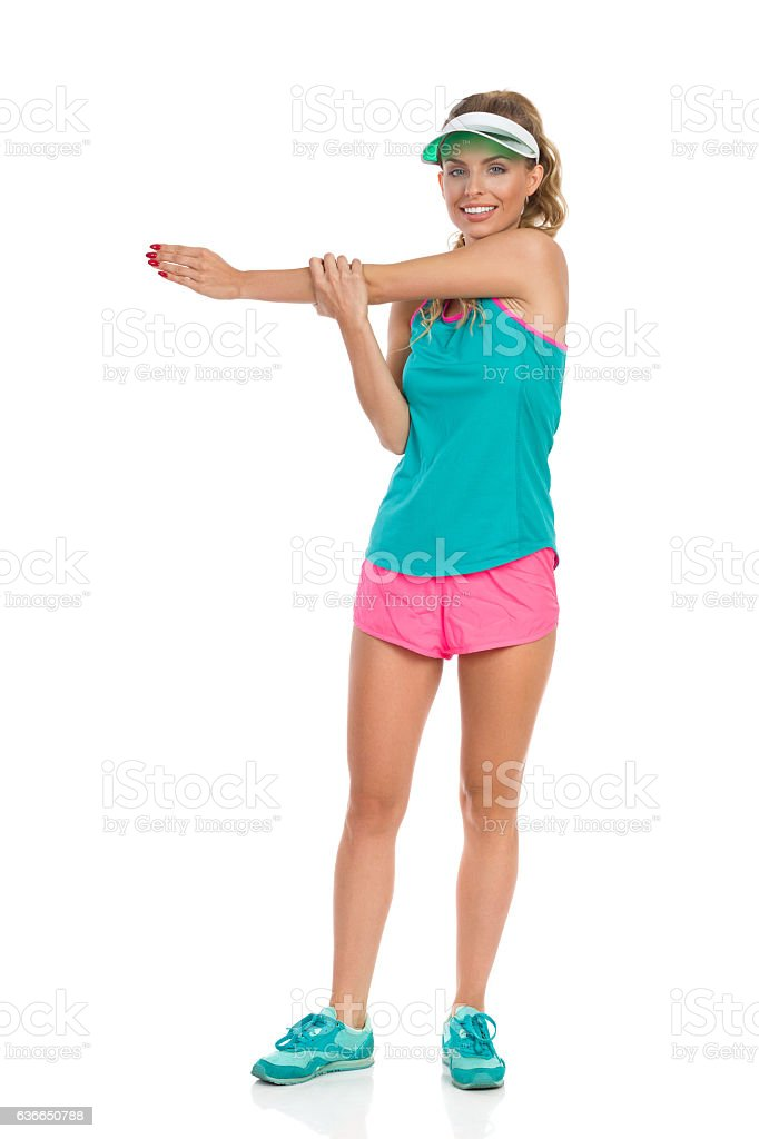 Woman Stretching Shoulder stock photo