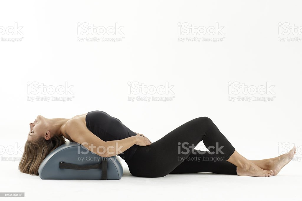 Woman stretching with pilates machine royalty-free stock photo