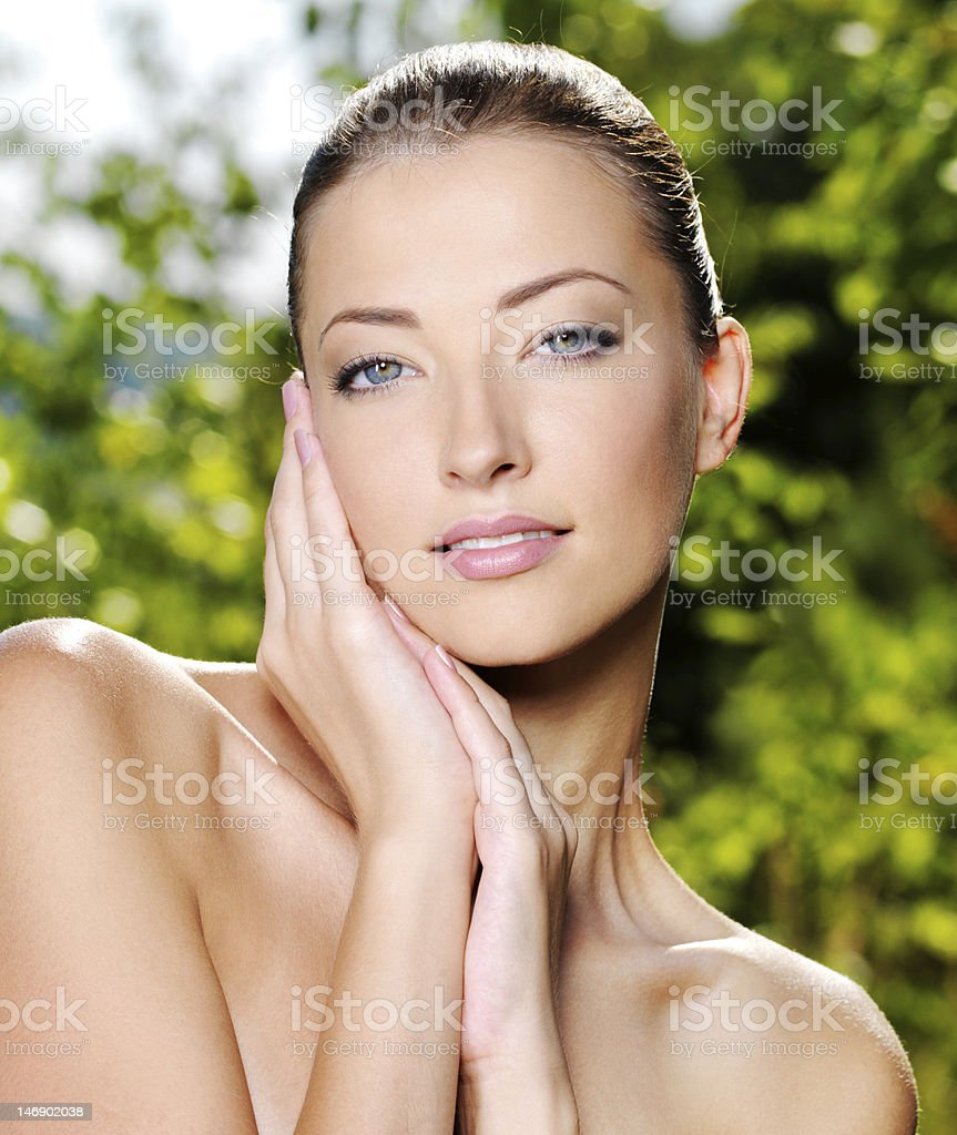 Woman stroking her fresh clean skin of a face royalty-free stock photo