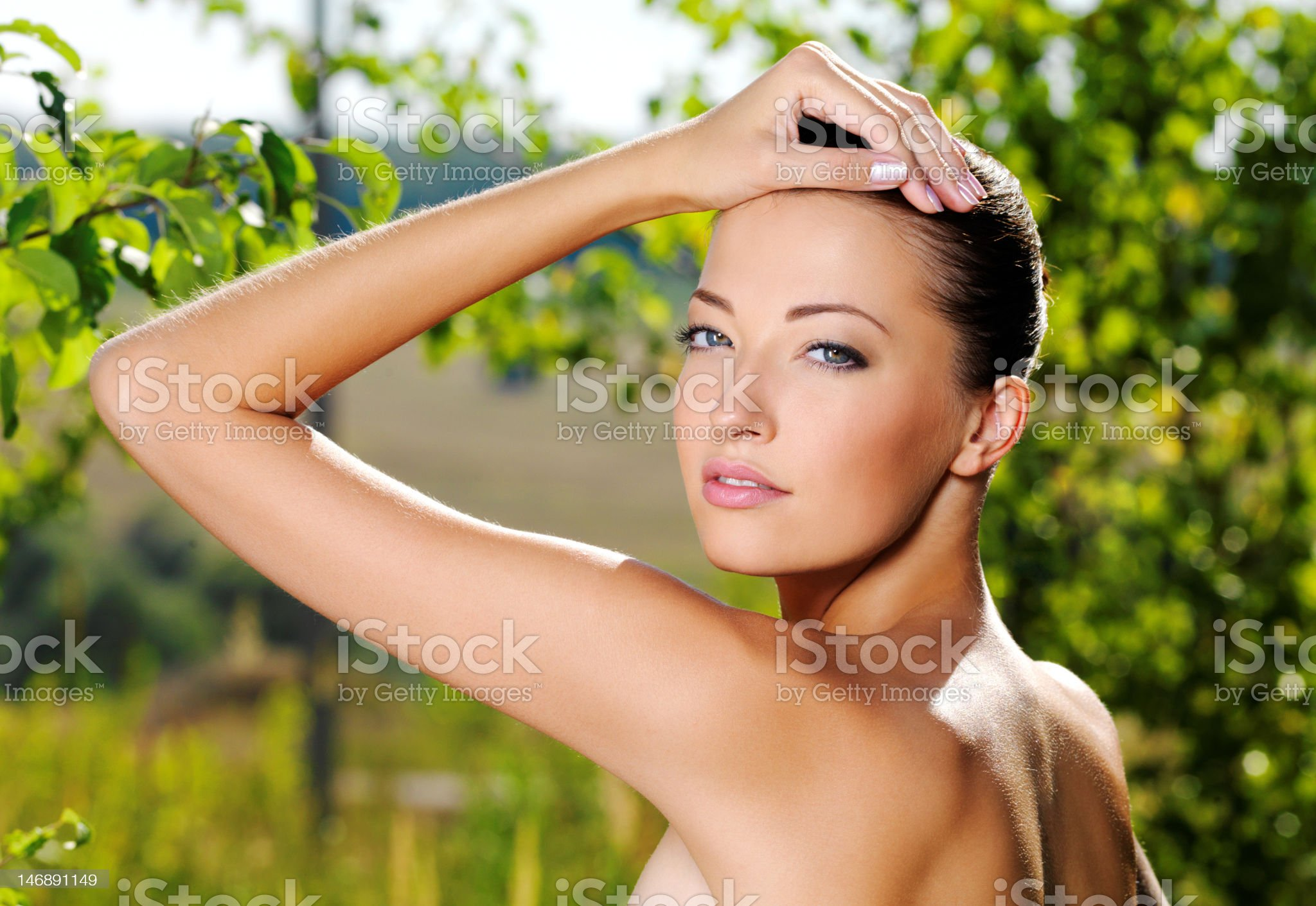 Woman stroking her fresh clean skin of face royalty-free stock photo
