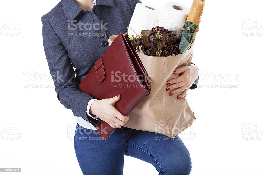 Woman struggles and holds bag and groceries stock photo