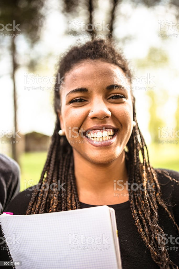 woman student happiness on the park stock photo