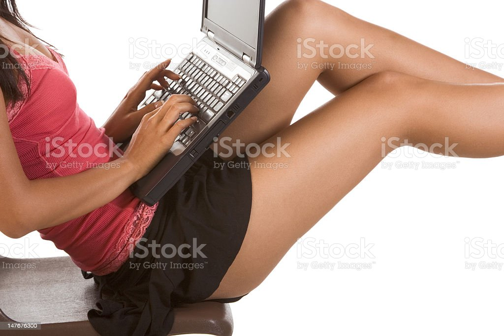 Woman Student with laptop on legs typing keyboard royalty-free stock photo