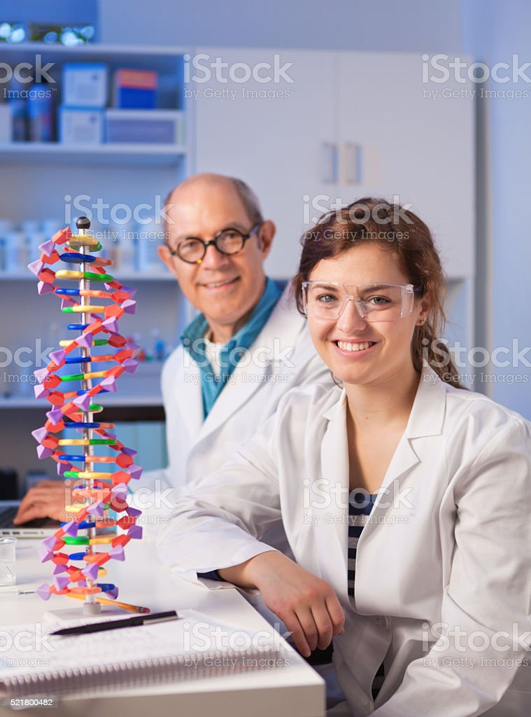 Woman Student with Teacher in Chemistry Laboratory stock photo
