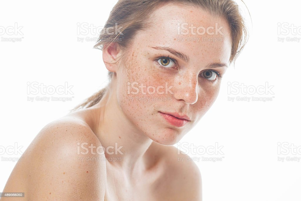 Woman studio beauty portrait freckled with long hair stock photo
