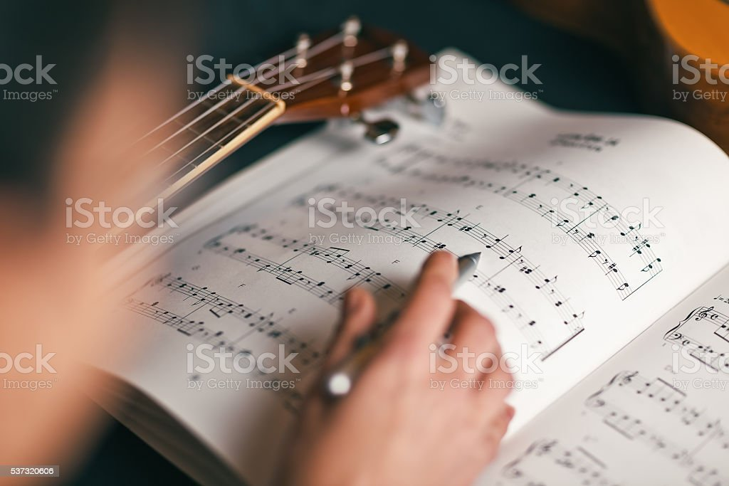 woman studying a musical score with shallow depth of field