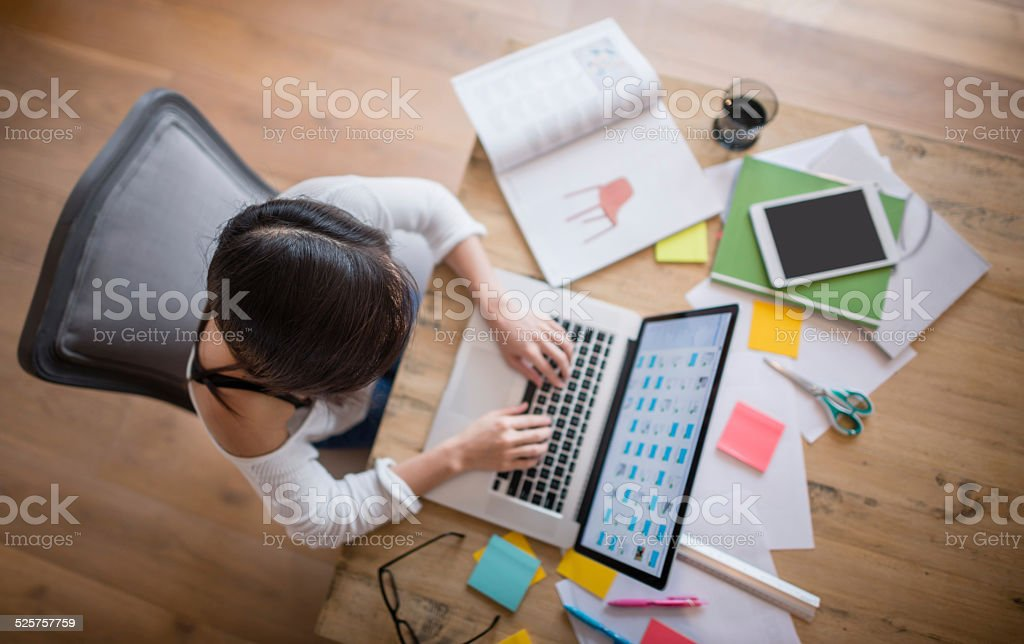 Woman studying at home stock photo