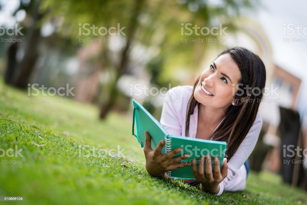 Woman studying at the park stock photo