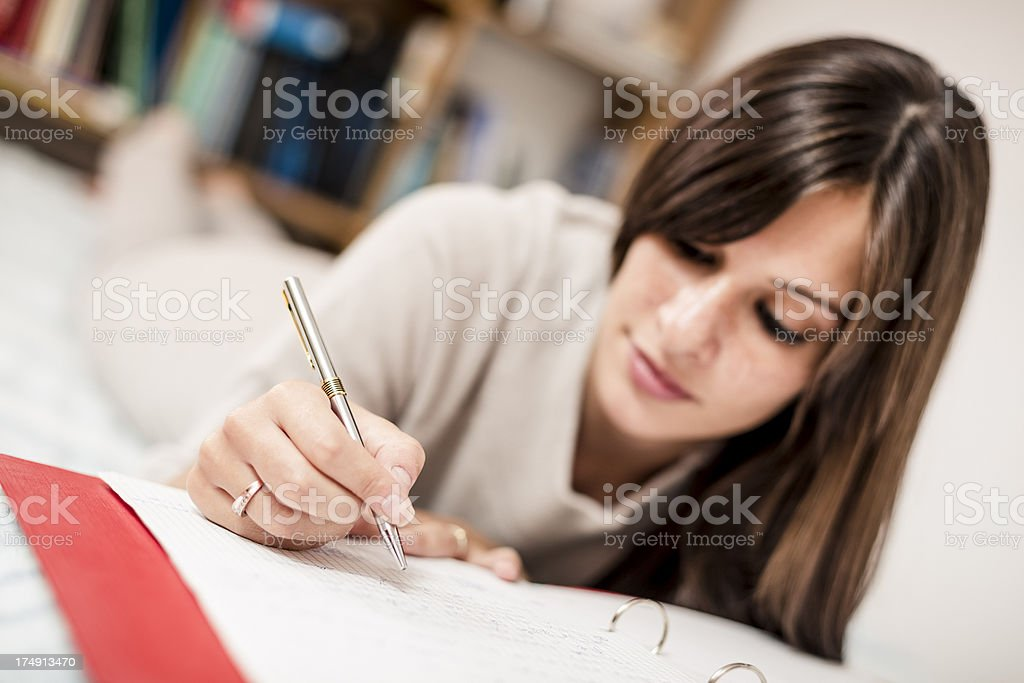 Woman studying for exams royalty-free stock photo