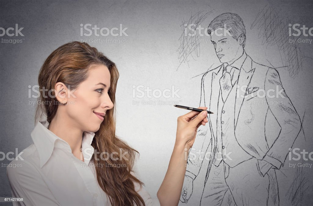woman stylist drawing sketch of male model dressed in suit stock photo