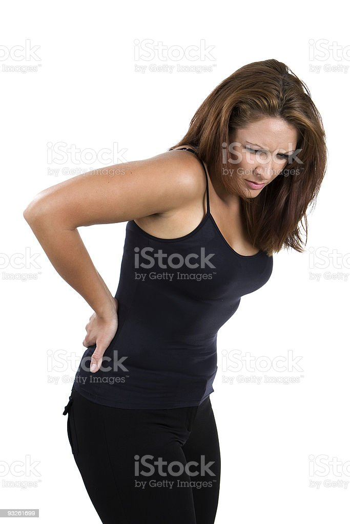 A woman suffering from back pain stock photo