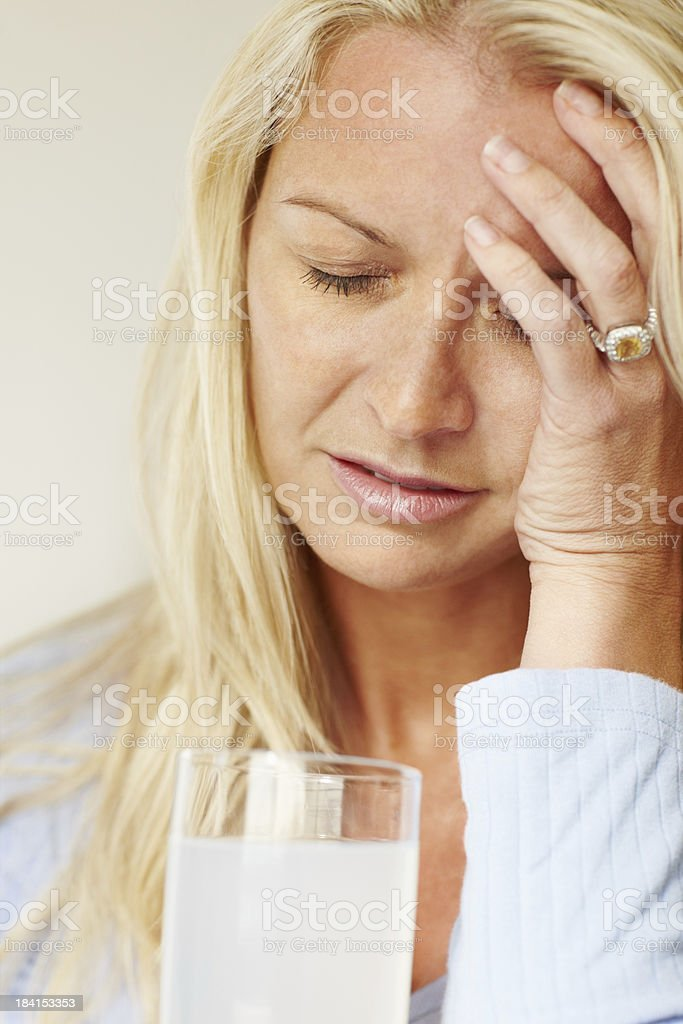Woman suffering from headache royalty-free stock photo
