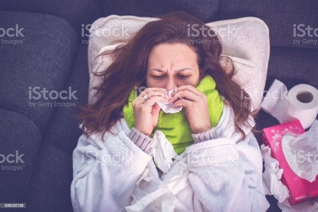 Woman suffering from influenza stock photo