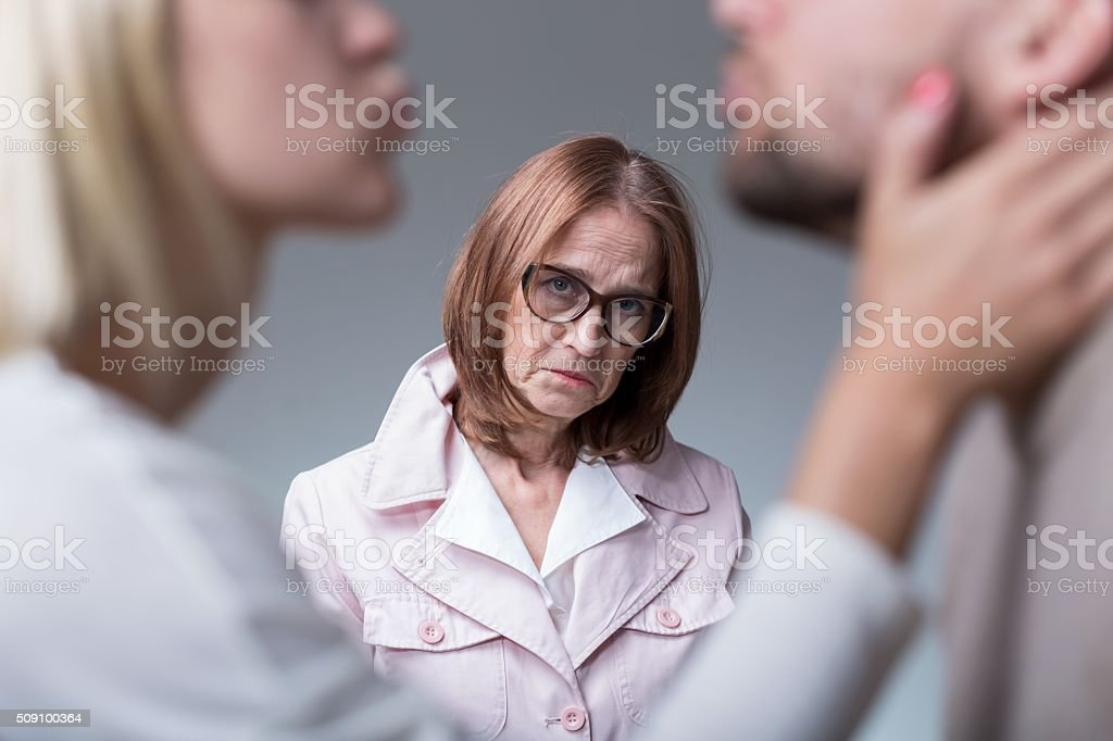Woman suffering from motherly love stock photo