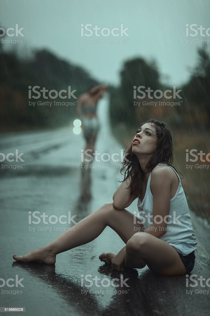 Woman suffering in the rain. stock photo