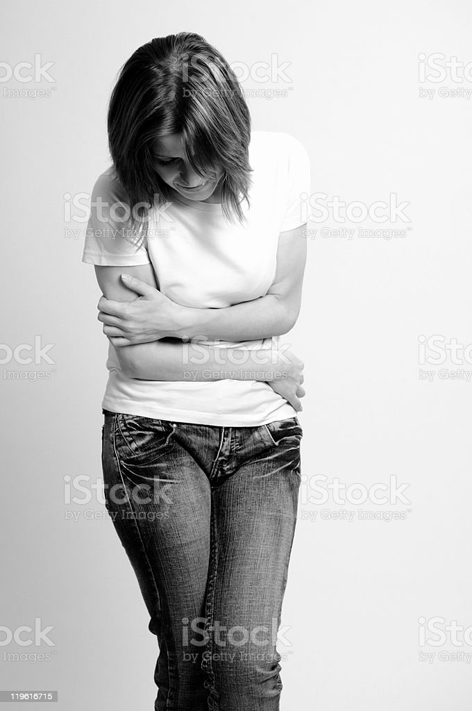 woman suffering of stomach ache royalty-free stock photo