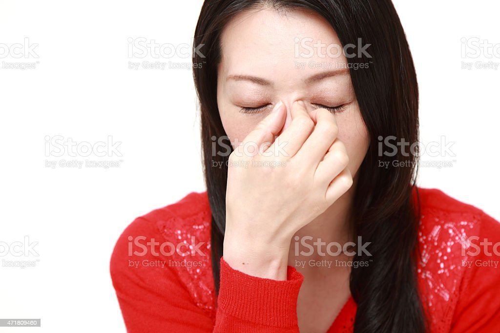 woman suffers from Asthenopia stock photo