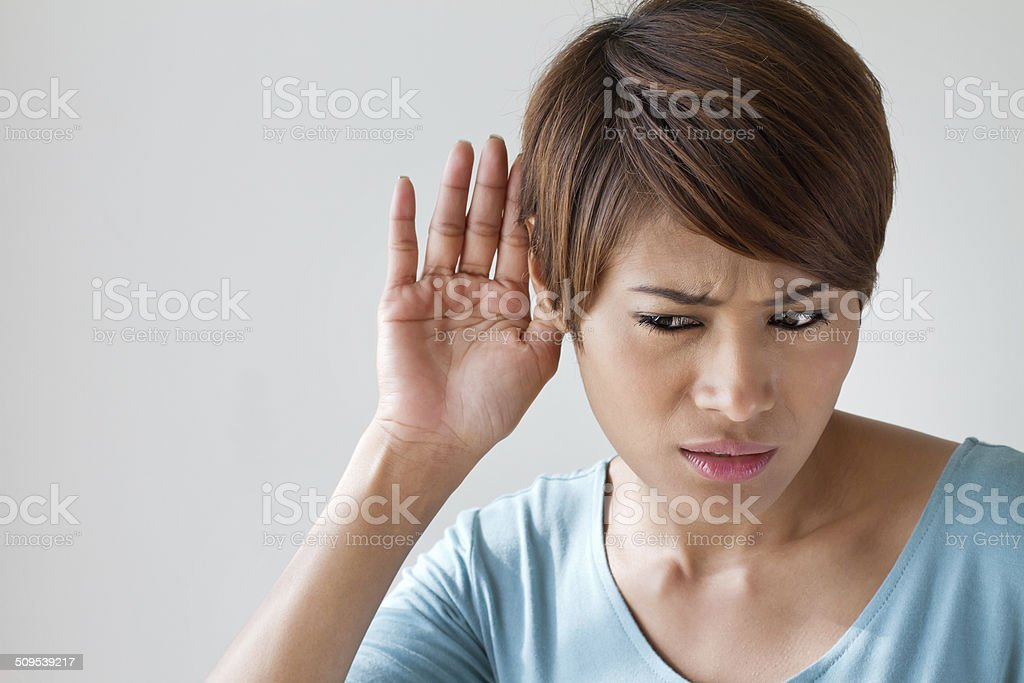 woman suffers from auditory impairment, hard of hearing stock photo