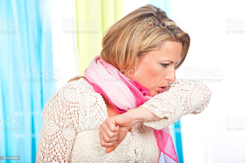 Woman suffers from coughing stock photo