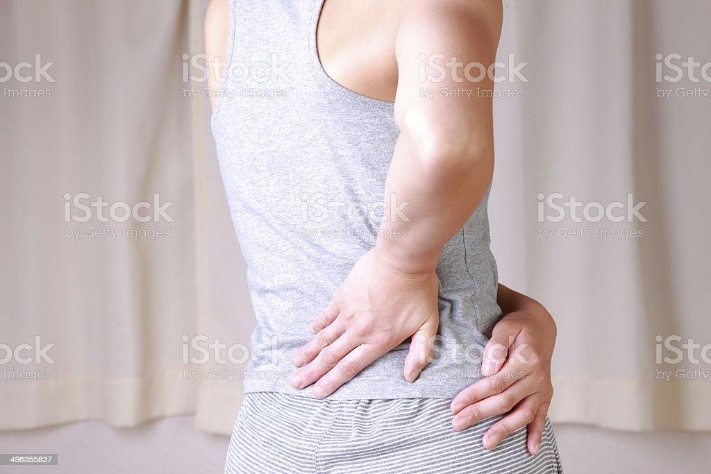 woman suffers from lumbago stock photo