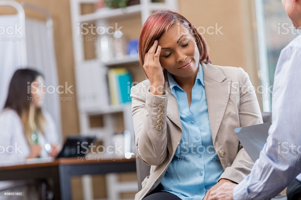 Woman suffers from migraine headache stock photo