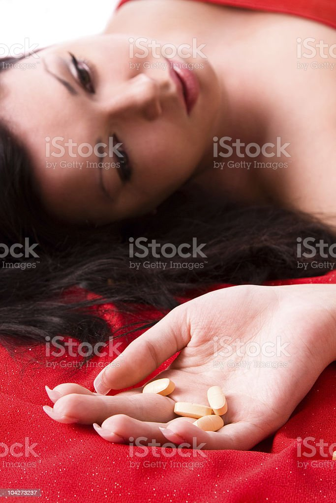 Woman suicide with pills royalty-free stock photo