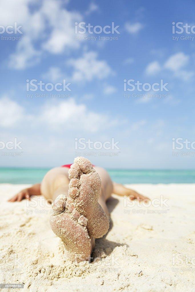 Woman Sunbather Sunbathing on Tropical Beach royalty-free stock photo