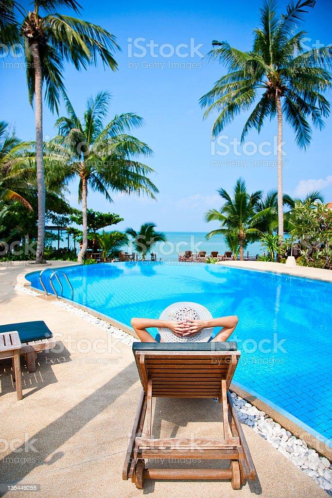 woman sunbathing in beach chair royalty-free stock photo