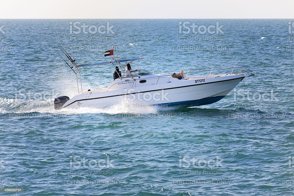 woman sunbathing on boat deck of speedboat in Dubai stock photo