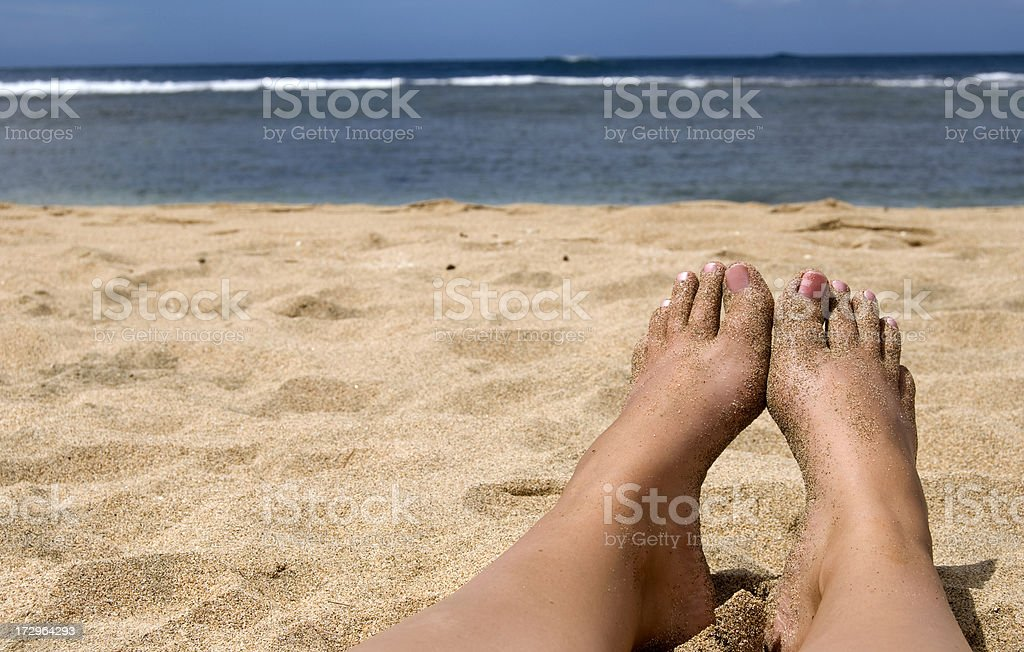 Woman Suntanning on the Beach royalty-free stock photo